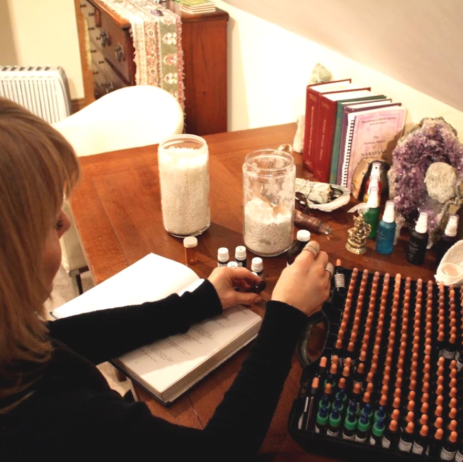 Katie Lee Epsom Homeopath preapring remedies at her desk