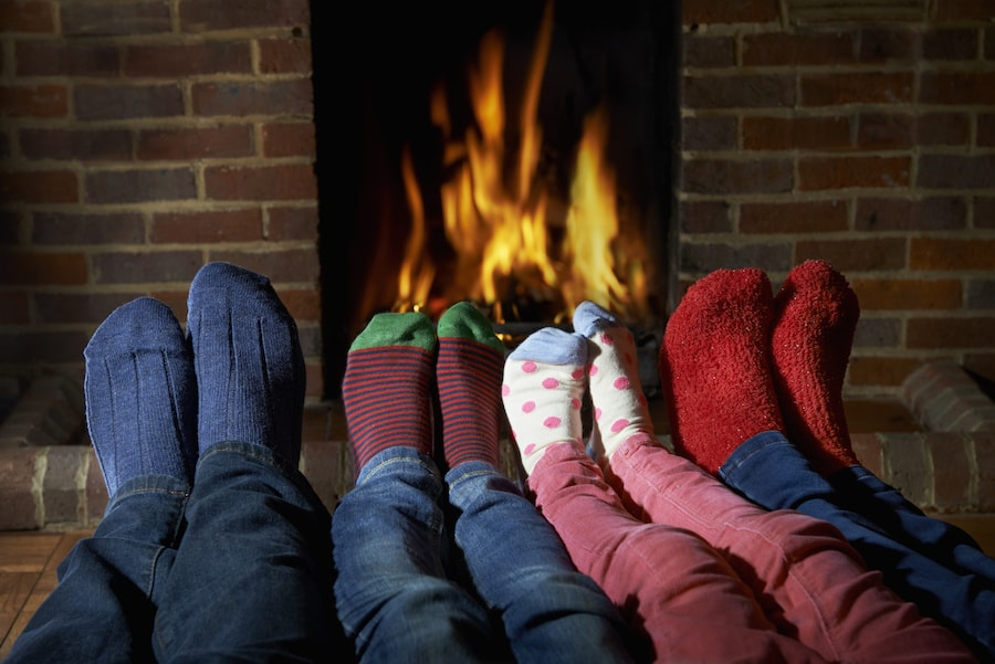 Family feet in front of an open fire