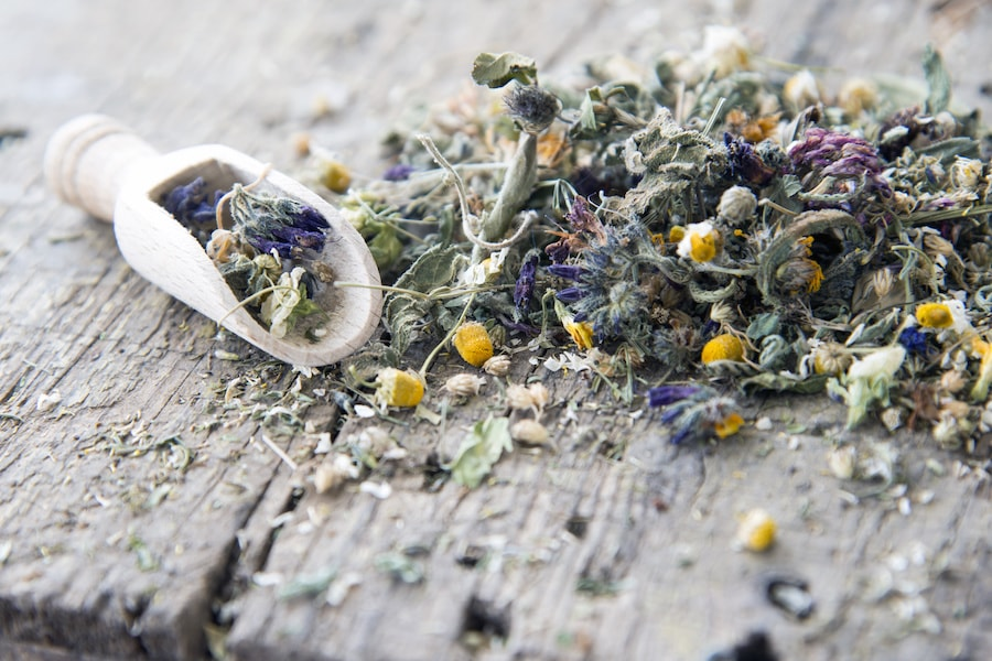 Dried flowers and natural healing remedies on a bench