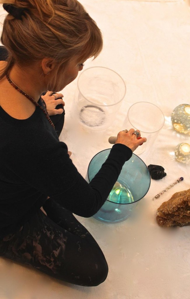 Epsom Homeopath Katie Lee using crystal singing bowls for relaxation