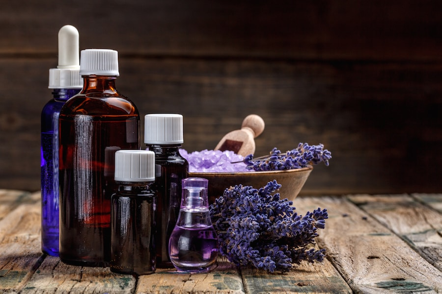 Lavender dried flowers and healing remedies and essential oils on a wooden bench