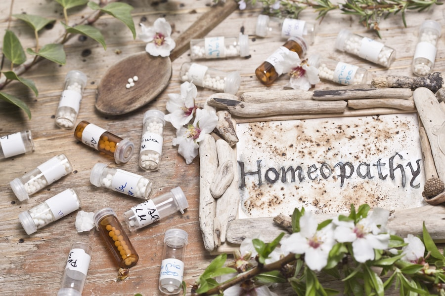 Homeopathy montage with remedies and natural products and flower essences